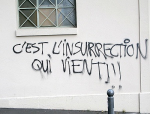 "Graffiti reading, ""the coming insurrection."""