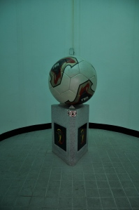 FIFA World Cup statue in the bathroom hallway. Random or perfect setting?